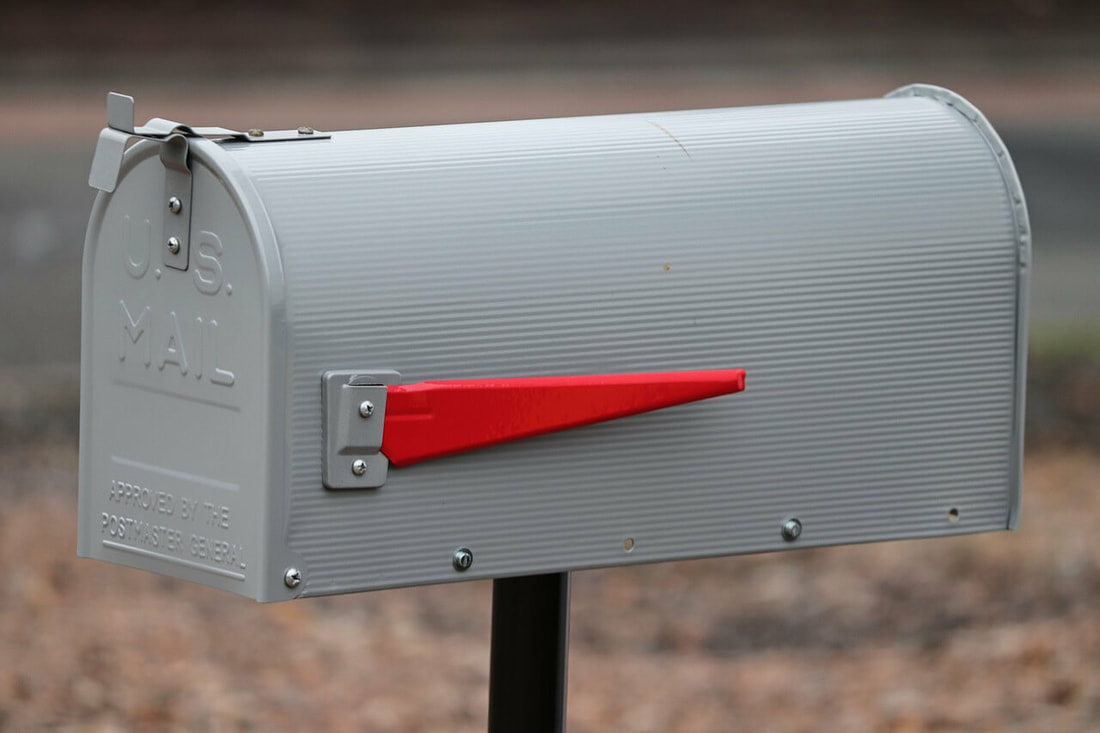 Mailbox by the road because using direct mail is a great marketing idea for financial advisors